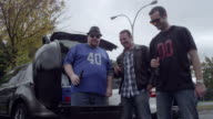 Friends tailgating in parking lot
