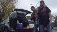 Friends tailgating