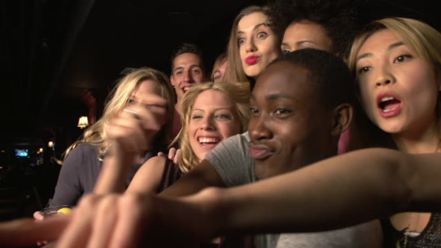 friends taking a selfie at a club