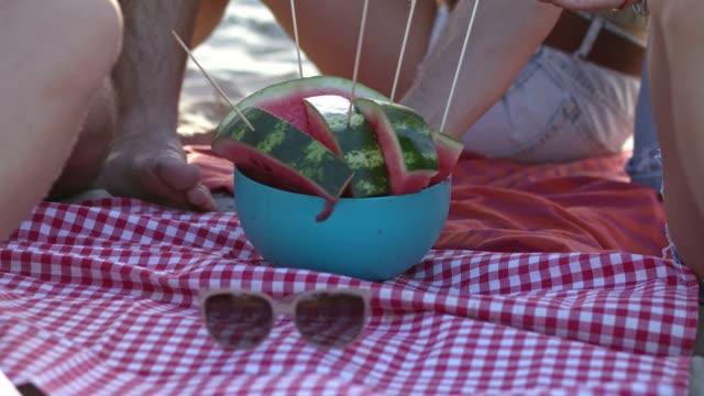 Friends taking watermelon