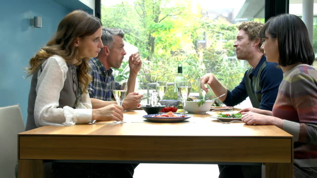 HD SUPER SLOW-MO: Friends Talking During Lunch