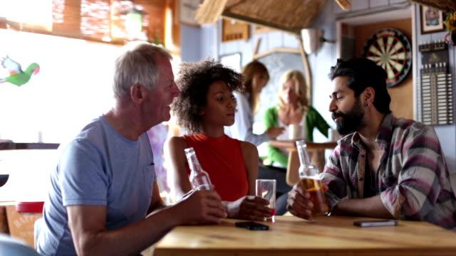 Friends Talking in a Bar