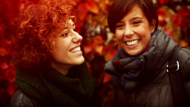 Friends talking in front of autumnal background