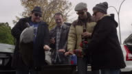 Friends toasting at a tailgating party
