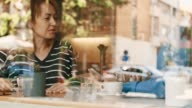 Friends using digital tablet in cafe