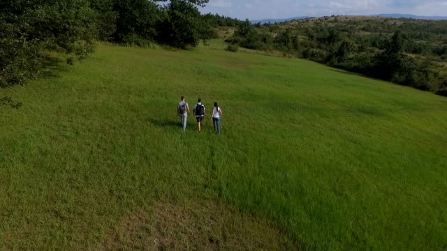 Friends walk in the nature