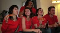 Friends watching television sport match