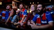 Friends watching their team