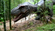 Frightened but curious a group of kindergarten pupils braved the rain to get an early glimpse of lifesized dinosaurs set to debut April 28 at the...