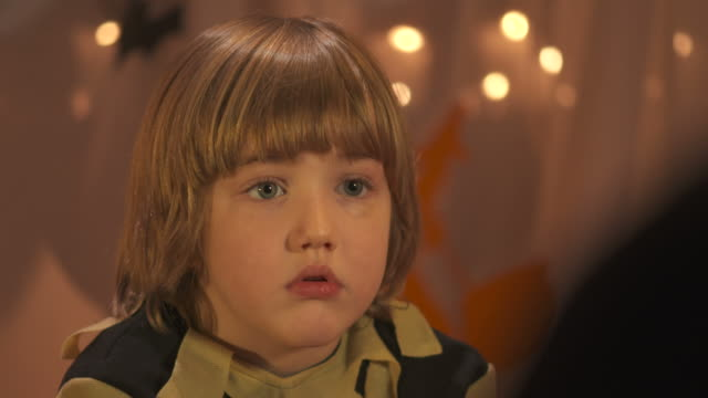 HD DOLLY: Frightened Little Boy Listening Halloween Stories