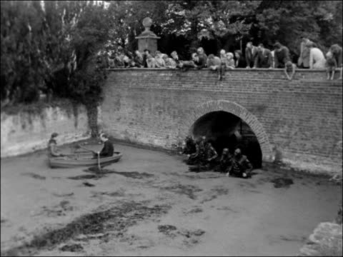 Frogmen search for treasure in Salisbury Hall moat ENGLAND Hertfordshire Salisbury Hall EXT House exterior / People looking over moat bridge PAN moat...