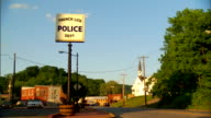 From a couple of vehicles car trucks on road to high sign 'French Lick Police Dept' rural town BG IN French Lick Indiana