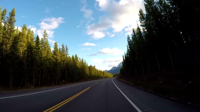 POV from car as it dives along mountain road