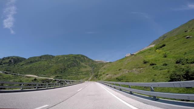 POV from car as it drives along mountain road