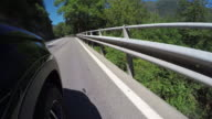 POV from car door, motoring on mountain road