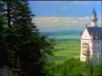 PAN from fir tree to wide shot Neuschwanstein Castle / Bavaria, Germany