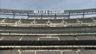 PAN from football field to Metlife signage / NFL logo / various signage of Metlife stadium in interiors of empty stadium Metlife Stadium Interiors 2...