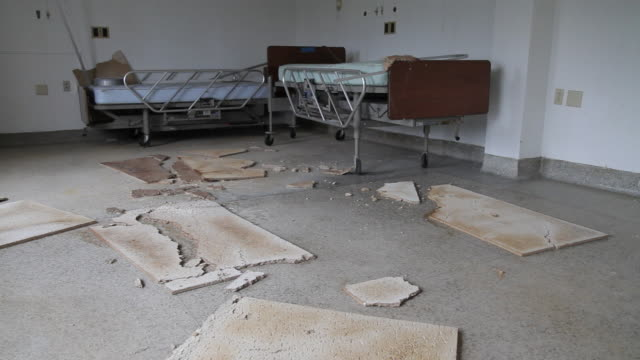 TD from hospital beds to trash on floor of empty room in closed hospital