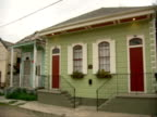 From row of ruined damaged houses along street to MS front of nicely renovated home LA levees natural disasters recovery rebuilding shotgun house