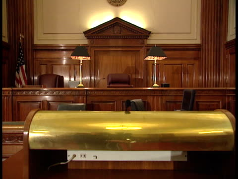 Empty judges' bench multiple seats lamp of stand lower FG Law crime hearing trial criminal guilty notguilty innocent judge witness questioning cross...