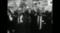 Front line of march includes Roy Wilkins Asa Philip Randolph Martin Luther King Jr and Walter Reuther head of auto workers