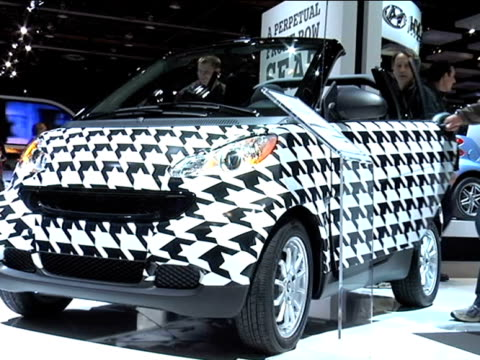 WS front quarter driver side video of smart fortwo passion cabriolet covered with a houndstooth wrap / WS rear three quarter passenger side view 2011...