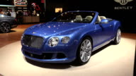 ZOWS front threequarter driver side view of Bentley convertible / WS driver side profile / CU W12 fender emblem / PAN RIGHT across entire convertible...