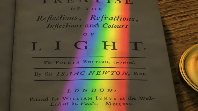 Frontispiece of Isaac Newton's 'Opticks', with a spectrum of light cast upon it by a rotating prism above.