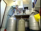 Frozen embryos destroyed ENGLAND London Churchill Clinic WC1 TCMS Embryo storage containers in drum of liquid nitrogen as one phial removed LA MS...