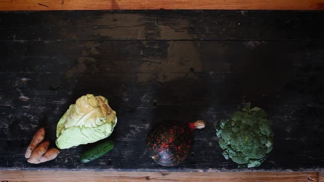 Fruit and vegetables in the European autumn presented on a black table