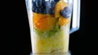 SLO MO Fruit being blended on black background