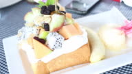 Fruits toasted bread serving with ice cream