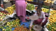 Fruits vendors in Kathmandu shopping area Medium Shot Truck Shot_Truck Shot