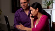 Frustrated Latin Couple Argue with Company over the Phone