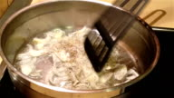 Frying and stirring onion