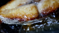 Frying fish close up