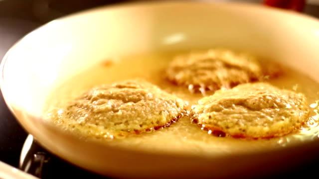 Frying pancakes.