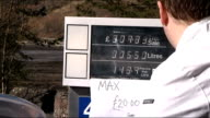 Fuel tanker drivers' will not strike over Easter / woman burned transferring petrol SCOTLAND Argyll Sign reading 'Max 20 pounds Sorry No Cans' on...