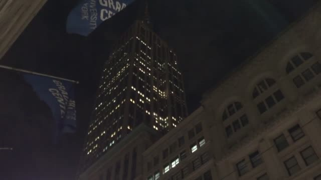 Full moon is seen over the darkened Empire State Building in respect for Brussels terror attackvictims