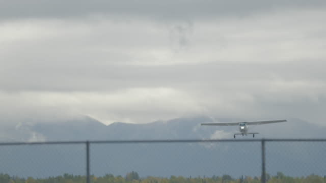 Full shot of a small airplane taking off from Merrill Field airport