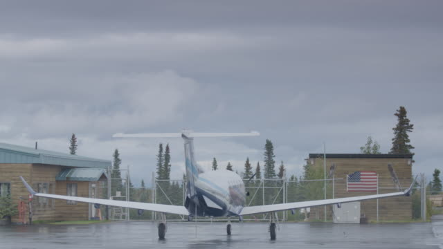 Full shot of an airplane parking at Iliamna airport