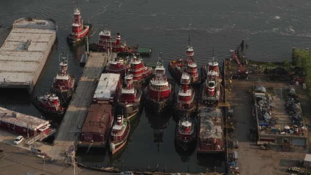 Full shot of McCallister Towing tugboats docked in a harbor