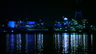 Full view of the industrial zone of Kitakyushu seen from Dokai Bay Blue lights of the industrial zone reflect on the water of Dokai Bay Long Shot