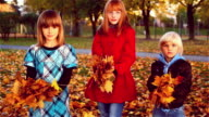 Fun loving family playing in the leaves.