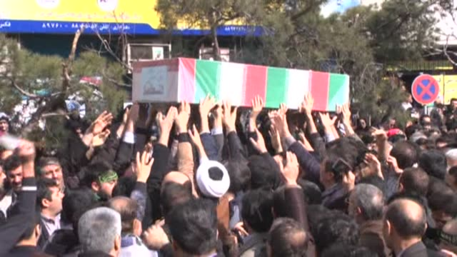 Funeral ceremony of 3 soldiers killed during the IranIraq War prolonged military conflict between Iran and Iraq during the 1980s is held in Iran's...