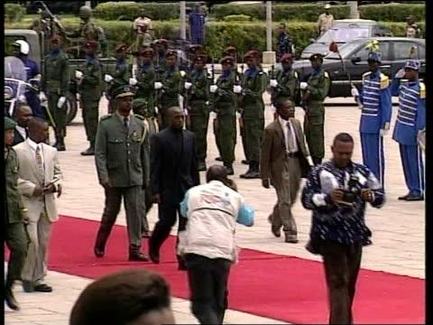 Kinshasa EXT GV Funeral procession of assassinated Congo President Laurent Kabila towards along red carpet MS Senior military figures along next...