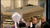 Funeral of Sir Jimmy Savile ***TO Yorkshire Leeds St Anne's Catholic Cathedral INT ** Music heard over following sequence ** Top shot gold coffin of...
