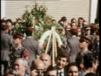Funeral of three policeman killed by antiFranco guerillas BV Guardia Civilia PAN MS PAN Guardia Civilia at attention GV Priests ZOOM in MS PM lays...