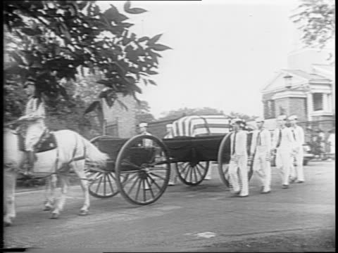 A funeral procession for Admiral John Sidney McCain winds through Arlington Cemetery / service men watch the burial / soldiers hold American flag...