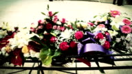 HD: Funeral Wreaths on A Hearse